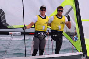 File: Peter Burling and Blair Tuke of New Zealand celebrate winning the Men's 49...