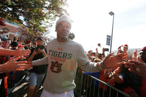 Carolina Panthers quarterback Cam Newton greets a Auburn fans before the first h...