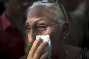 Vendor Lereida Sanchez, 54, cries during a protest near the Ecuadorean embassy a...