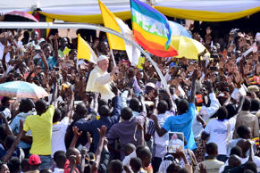 Crowds cheer as Pope Francis arrives at Kololo airstrip in Kampala, November 28, 2015.