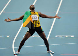 FOR USE AS DESIRED, YEAR END PHOTOS - FILE - Jamaica's Usain Bolt celebrates winning gold in the men's 200-meter final at the World Athletics Championships in the Luzhniki stadium in Moscow, Russia, Saturday, Aug. 17, 2013. (AP Photo/Martin Meissner, File)