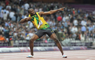 File photo dated 09-08-2012 of Jamaica's Usain Bolt does his trademark 'Lightening Bolt' after winning the gold medal in the Men's 200m final at the Olympic Stadium, London.  Martin Rickett/PA WIRE/Press Association