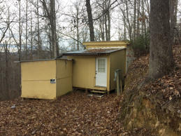 A small shack with no electricity or running water where where Planned Parenthood clinic shooting suspect Robert Lewis Dear spent time, is shown Saturday, Nov. 28, 2015, about a half-mile up a twisty dirt road near Black Mountain, N.C.