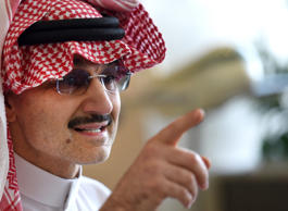 Saudi Arabia's billionaire Prince Alwaleed bin Talal speaks to reporters during ...