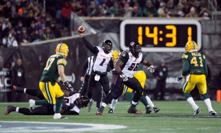 Redblacks quarterback Henry Burris throws the ball during the 103rd Grey Cup.