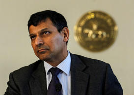 File: Reserve Bank of India (RBI) Governor Raghuram Rajan prepares to read the bi-monthly monetary policy statement at a news conference at the RBI headquarters in Mumbai April 1, 2014.