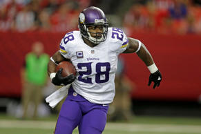 Minnesota Vikings running back Adrian Peterson runs against the Atlanta Falcons during the first half of an NFL football game, Sunday, Nov. 29, 2015, in Atlanta.