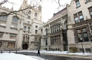 A walker strolls through the University of Chicago campus in Chicago, Illinois, U.S., on Friday, Dec. 11, 2009.