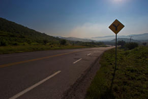 FILE: An empty stretch of highway leads to the city of Iguala, in the Mexican st...