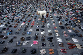 Pairs of shoes are symbolically placed on the Place de la Republique, after the cancellation of a planned climate march following shootings in the French capital, ahead of the World Climate Change Conference 2015 (COP21), in Paris, France, November 29, 2015. REUTERS/Eric Gaillard ...