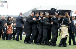 Former All Black Jonah Lomu's casket is carried out of Eden Park for his memorial service followed by his widow Nadene Lomu and her sons, Brayley Lomu and Dhyreille Lomu