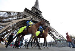 Mounted French Republican Guards patrol under the Eiffel Tower as the French capital remains under a high security alert following recent fatal shootings in Paris, France, November 28, 2015.