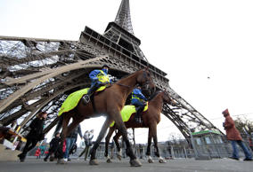 Mounted French Republican Guards patrol under the Eiffel Tower as the French cap...