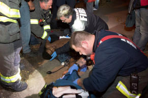 In this Nov. 23, 2015 photo, emergency responders aide one of five protesters shot on Nov. 23, 2015, near the site of an ongoing protest over the fatal shooting of a black man by a police officer in Minneapolis.