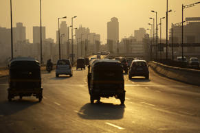 File: Vehicles drive along a stretch of the Western Express Highway at Bandra East during the evening rush hour in Mumbai, India, on Friday, April 4, 2014.