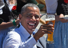 US President Barack Obama holds a glass of beer in the village of Kruen, souther...