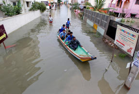 File: Rescue workers on a boat move people to safety at a residential area that was water-logged following heavy rains in Chennai, Tamil Nadu state, India, Monday, Nov.16, 2015.