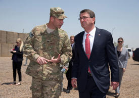 U.S. Defense Secretary Ash Carter arrives with Col. Otto Liller, commander, 1st ...