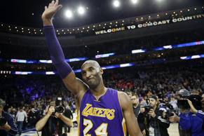 Los Angeles Lakers' Kobe Bryant waves to the crowd after an NBA basketball game ...