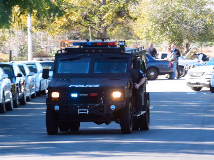 A swat team arrives at the scene of a shooting in San Bernardino, Calif., on Wednesday, Dec. 2, 2015.