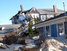 This file photo shows a house on the beach destroyed by Superstorm Sandy .