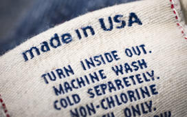 Cotton denim jean material with 'Made in USA' label. iStockphoto/Getty Images