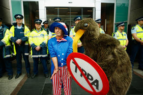 Anti TPPA protestors gather around the US Embassy following a protest march down Queen Street on August 15, 2015 in Auckland, New Zealand. The Trans-Pacific Partnership Agreement (TPPA) is a proposed regional free trade deal between 12 countries in the Asia-Pacific region.