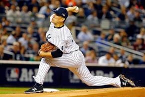 Masahiro Tanaka of the New York Yankees throws a pitch in the first inning against the Houston Astros during the American League Wild Card Game at Yankee Stadium on October 6, 2015 in New York City.