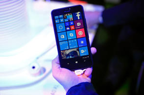 A visitor holds a Windows Lumia 640 XL smartphone in the Microsoft Corp. pavilion at the Mobile World Congress in Barcelona, Spain, on Monday, March 2, 2015. Microsoft Corp unveiled on Tuesday a new line of Lumia smartphones and an updated version of its wearable fitness tracker, Microsoft Band, that will run on Windows 10, its latest operating system.