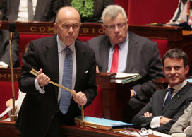 From left, French Interior Minister Bernard Cazeneuve, French Junior Budget Minister Christian Eckert and French Prime Minister Manuel Valls attend a session of questions to the government at the National Assembly in Paris on October 6, 2015
