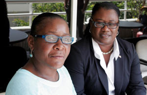 Marlene Pinnock, left, poses with her attorney, Caree Harper during an interview Sunday Aug. 10, 2014 in Los Angeles.