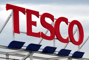 Tesco profits halve as it struggles with turnaround