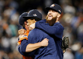 Houston Astros relief pitcher Luke Gregerson, left, Carlos Gomez, and Dallas Keucel celebrate after the Astros shutout the New York Yankees 3-0 in the American League wild card baseball game at Yankee Stadium in New York, Tuesday, Oct. 6, 2015.