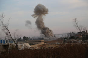 Smoke rises after Russian airtrikes hit ammunition-stores and bases of two oppos...