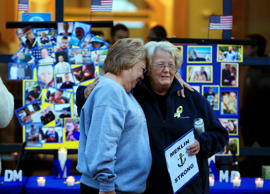 Deborah Dyer, right, is hugged by Judy Marzolf prior at vigil of hope held at Maine Maritime Academy for the missing crew members of the U.S. container ship El Faro, Tuesday evening, Oct. 6, 2015, in Castine, Maine. Dyer's nephew, Dylan Meklin, of Rockland, Maine, is one of the four Maine Maritime Academy graduate who are missing after the El Faro vanished near the Bahamas during Hurricane Joaquin.