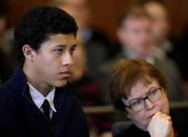 Philip Chism, 15, from Danvers, Mass., and his attorney Denise Regan look toward the bench in a courtroom at his arraignment on a second rape charge in Salem Superior Court in Salem, Mass., Thursday, Jan. 30, 2014.