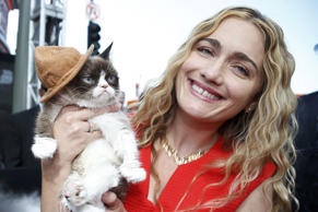 Grumpy Cat arrives with his owner Tabatha Bundesen at the 2014 MTV Movie Awards in Los Angeles.
