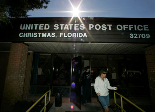 "After mailing Christmas cards, customers leave the post office in Christmas, Fla., Monday, Dec. 17, 2007. Patrons come from all over to mail their holiday cards and packages in order to have the postmark, ""Christmas, Fl."" (AP Photo/John Raoux)"