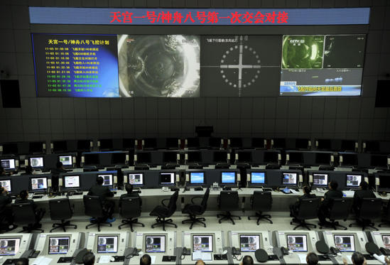 Chinese scientists monitor the docking of the Tiangong-1 space lab module and the Shenzhou VIII spacecraft in space at the Jiuquan Satellite Launch Centre in the northwestern province of Gansu on November 3, 2011. China took a crucial step towards fulfilling its ambition to set up a manned space station by completing its first successful docking high above Earth, state media reported. CHINA OUT AFP PHOTO (Photo credit should read STR/AFP/Getty Images)