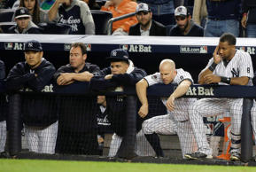 New York Yankees pitcher Masahiro Tanaka, far left, Dellin Betances, second from left, Brett Gardner, second from right, and Chris Young, right, watch from the dugout against the Houston Astros during the ninth inning of the American League wild card baseball game, Tuesday, Oct. 6, 2015, in New York. The Astros won 3-0 to advance to the American League Division Series.