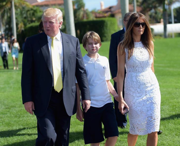 Donald Trump, his wife, Melania, and their son, Barron, attends Trump Invitational Grand Prix Mar-a-Lago Club in Palm Beach, Fla.