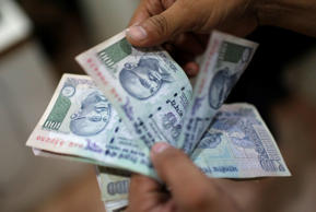 Rupee hits 8-week high of 64.95 vs USD, up 46 paise