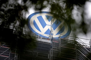 A Volkswagen logo stands on the roof of the company's headquaters in Wolfsburg, ...