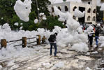 A pedestrian walks among clouds of toxic foam in Bangalore, India. (Debasish Ghosh)