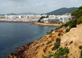 Hotels line the bay of Santa Eularia in Ibiza, Spain.  Ibiza is popular for drawing tourists.