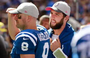 Indianapolis Colts' Andrew Luck (12) talks with quarterback Matt Hasselbeck (8) during the first half of an NFL football game against the Jacksonville Jaguars, Sunday, Oct. 4, 2015, in Indianapolis.