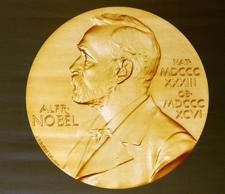 The laureate medal featuring the portrait of Alfred Nobel is seen before a press...