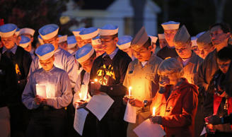 Maine Maritime Academy students bow their heads during a vigil of hope for the m...