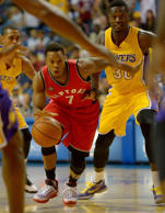 Los Angeles Lakers forward Julius Randle (30) looks on as Toronto Raptors guard Kyle Lowry (7) drives to the basket in the first quarter of the game at Citizens Business Bank Arena.