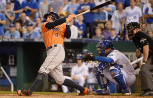 Houston Astros right fielder George Springer (4) hits a solo home run against the Kansas City Royals in the fifth inning in game one of the ALDS at Kauffman Stadium on Oct. 8, 2015 in Kansas City, Mo.